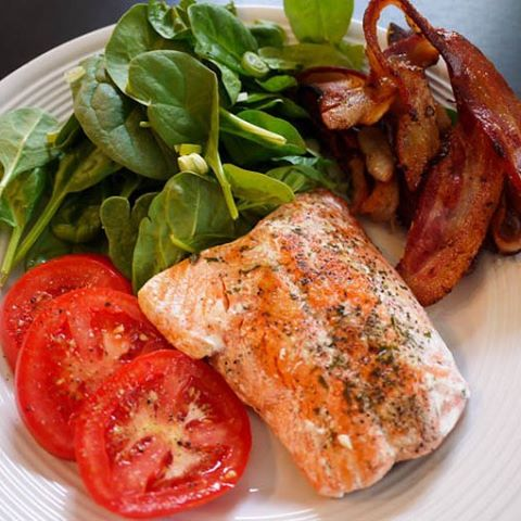 Baked Salmon Sliced Seasoned Tomatoes Spinach Salad and Crispy Baconhellip